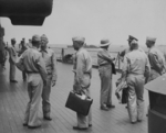 Admiral Raymond Spruance and Admiral Chester Nimitiz aboard USS New Jersey, date unknown, photo 2 of 4; note Robert Elliott in background, touching face