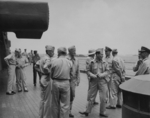 Admiral Raymond Spruance and Admiral Chester Nimitiz aboard USS New Jersey, date unknown, photo 4 of 4; note Robert Elliott in background, with camera