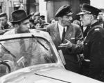 Policeman Frank Kotlewski speaking with Julien Bryan through an interpreter, Warsaw, Poland, 9 Sep 1939