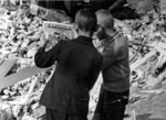Polish boys reading Mickey Mouse comics in ruins, Warsaw, Poland, Sep 1939
