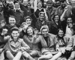 Prisoners celebrating, Dachau Concentration Camp, Germany, 29 Apr 1945; note female prisoners in foreground