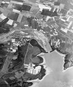 Aerial reconnaissance photo over Möhne Dam, showing flooding, Soest, Westfalen-Süd, Germany, late 17 May or 18 May 1943
