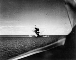 Japanese cruiser Kumano bombed by carrier planes in the Sibuyan Sea, Philippines, 26 Oct 1944. She lost her bow the previous day from a torpedo fired by USS Johnston in the opening shot of the Battle off Samar.