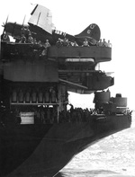 Fantail of the carrier USS Hancock in the western Pacific, Dec 1944. Note SB2C Helldiver on the after flight deck and the aircraft's horseshoe tail geometric identifying it as from Bombing Squadron 7 from the Hancock