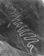 The 24-Turns section of the Kunming-Chungking (Chongqing) Road in China climbs 650 vertical feet using 1.8 miles of road to cover one-quarter of that distance laterally, Guizhou Province, China, 1944, photo 2 of 2