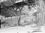 Bombed hangar at Mourmelon-le-Grand, France after a German attack on the airfield, 14 May 1940; note wreck of a Miles Magister and at least two Fairey Battle aircraft