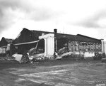 Wrecked P-40 fighters in front of the damaged Hangar #3 at Wheeler Field, Oahu, Hawaii following the Japanese Pearl Harbor attack. 11 Dec 1941 photo.