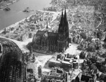 Cathedral at Cologne, Germany with the collapsed Deutz Suspension Bridge beyond, Mar 1945.