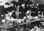 The signing of the Tripartite Pact at the Reich Chancellery in Berlin, 27 Sep 1940.  The signers are, left to right, Galeazzo Ciano of Italy, Joachim von Ribbentrop of Germany, and Saburō Kurusu of Japan.