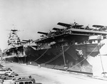 Aircraft carrier USS Hornet (Yorktown-class) at Pier 7, Norfolk Operating Base, Portsmouth, Virginia, United States, Feb 1942. Note F4F-3 Wildcats of Fighting Squadron 3 and SBC-4 Helldiver I's from Bombing Squadron 8.