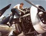 AMM1c Brannam of VF-16 working on the Pratt and Whitney R-2800 engine of a Grumman F6F-3 Hellcat fighter aboard USS Lexington (Essex-class) during a lull between strikes on Milli and Kwajalein, early Dec 1943.