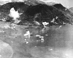 The port of Honk Kong under attack by American planes from Task Force 38, 16 Jan 1945, while Task Force 38 was still in the South China Sea.