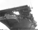 An underside view of the USS Randolph flight deck 12 Mar 1945, the day after a Yokosuka P1Y Ginga (Frances) special attack aircraft crashed into Randolph's stern as she rode at anchor in the Ulithi lagoon.