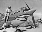 "Curtis Tomahawk IIA fighter named ""Menace"" with Flying Officer Neville Bowker of RAF 112 Squadron in North Africa, mid-1941."