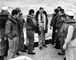 Time Magazine war correspondent William Walton, in the expensive coat, speaking with crewmen aboard the Coast Guard cutter Spencer, early 1943 in the Atlantic.