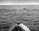 View from United States Coast Guard cutter Spencer as she approached U-175 after being forced to the surface by depth charges and just before U-175 sank, North Atlantic, 500 nautical miles WSW of Ireland, 17 Apr 1943.