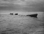Boarding party from Coast Guard cutter Spencer approaching the U-175 after the sub was forced to the surface by depth charges, North Atlantic, 500 nautical miles WSW of Ireland, 17 Apr 1943. Minutes later, U-175 sank.