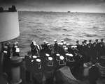 Funeral services aboard United States Coast Guard cutter Spencer 18 Apr 1943 for sailor killed in action against U-175 the day before in the North Atlantic.
