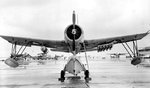 OS2U Kingfisher scout plane with five Mousetrap anti-submarine rockets mounted under one wing for testing purposes, Banana River, Florida, United States, 11 Dec 1942. Photo 1 of 4.