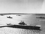 American aircraft carrier USS Wasp (Wasp-class) at anchor in Scapa Flow, Orkney Islands, Scotland, United Kingdom, 6 Apr 1942. Cruiser USS Wichita is seen at right and battleship USS Washington in the center.
