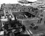 The after-flight deck of the USS Bunker Hill in Puget Sound Naval Shipyard's Dry Dock No. 5 shortly after arriving at Bremerton, Washington, United States, 16 Jun 1945. Note the collapsed aircraft elevator.