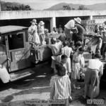 Recently freed internees of Stanley Internment Camp boarding lorries which would take them to ships for their trips to Europe, Hong Kong, 18 Sep 1945