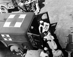 Wounded Italian soldiers from the Sicily invasion being transferred from a ship to waiting WC54 ambulances at Mers-el-Kebir, Algeria, July 1943