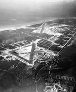 Aerial view of Ewa Field (near) and Barbers Point Naval Air Station (beyond) on Oahu, Hawaii, 20 Jan 1943.