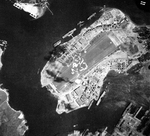 Aerial view straight down onto Ford Island, Pearl Harbor, Oahu, Hawaii, 18 Aug 1943.