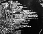 Aerial view of the Boston Navy Yard, 8 Mar 1943. Note the three-masted square-rigged frigate and veteran of the War of 1812 USS Constitution near the top of the image.