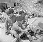 Comrades of Rifleman John Beeley of 1st King's Royal Rifle Corps who was posthumously awarded the Victoria Cross at Battle of Sidi Rezegh on 21 Nov 1941 are working on his cross, 22 May 1942.