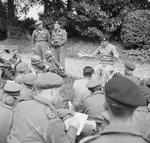 General Montgomery meeting with war correspondents at his headquarters at Château de Cruelly, France during the Normandy campaign, 11 Jun 1944.