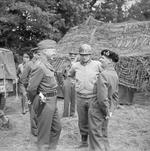 Generals George Patton, Omar Bradley, and Bernard Montgomery meeting at Montgomery's headquarters at Blay, Normandy, France, 7 Jul 1944. Patton and Montgomery seem to be enjoying a tense laugh.