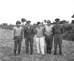 Generals Courtney Hodges, Henry (Harry) Crerar, Bernard Montgomery, Omar Bradley, and Miles Dempsey after a tactical meeting in a Normandy hayfield, 21 Aug 1944.