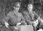 Generals Miles Dempsey and Dwight Eisenhower in the back of a Jeep during a meeting at Field Marshal Bernard Montgomery's headquarters in northern France, Sep 1944.
