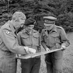 General Brian Horrocks of British XXX Corps, Field Marshal Bernard Montgomery, and Prince Bernhard of the Netherlands discuss the upcoming Operation Market Garden at Montgomery's headquarters in France, 8 Sep 1944.
