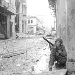 A British paratrooper with the 5th Scots Parachute Battalion takes cover in Athens, Greece during operations against ELAS (the Greek People