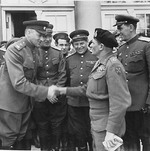 Soviet General Konstantin Rokossovsky, left, greeting British Field Marshal Bernard Montgomery, right, during a visit to Rokossovsky's headquarters in Wismar, Germany, 7 May 1945.