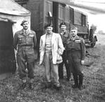 Prince Felix of Luxembourg, General Bernard Montgomery, French Colonel Candeau, and Brigadier General Christopher Peto at 21st Army Group headquarters at Blay, Normandy, France, 1 Sep 1944.