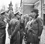 British General Brian Horrocks (left) and King George VI of the United Kingdom meeting with the men of the American 82nd Airborne Division who captured the bridges at Grave and Nijmegen during Market Garden.