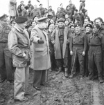 British Prime Minister Winston Churchill and Field Marshal Bernard Montgomery with the men of 79th Armoured Division, 25 Mar 1945. General Miles Dempsey is at left.