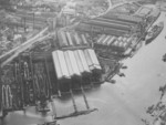 Aerial view of Germaniawerft yard in Kiel, Germany, early 1900s; note battleship Deutschland or Schleswig-Holstein under construction, 4 torpedo boat slips ahead of the battleship, and building slips V through VIII