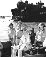 General Douglas MacArthur in an LCVP getting ready to go ashore on Lingayen Gulf Blue 1 landing beach, Luzon, Philippines, 9 Jan 1945. Note Chief of Staff Lt General R.K. Sutherland beside him.