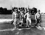 General Douglas MacArthur coming ashore from an LCVP on Lingayen Gulf Blue 1 landing beach, Luzon, Philippines, 9 Jan 1945. Note Chief of Staff Lt General R.K. Sutherland beside him.