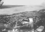 View of Tecklenborg shipyard, Bremerhaven, Germany, 1920s; note two merchant ships tied up in the equipping peir (middle right) and shipyard administration building (white building, bottom center)
