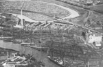 Aerial view of the slips of Tecklenborg shipyard and the twisting Geeste River, Bremerhaven, Germany, date unknown