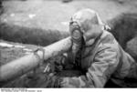 German soldier with Panzerschreck launcher and gas mask, southern Ukraine, circa Dec 1943-Jan 1944, photo 2 of 2