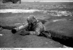 German soldier with Panzerschreck launcher and gas mask, southern Ukraine, circa Dec 1943-Jan 1944, photo 1 of 2