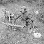 Demonstration of a captured German Panzerschreck weapon by an instructor of UK 59th Division, France, 1 Aug 1944