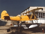 N3N-1 Canary trainer (Bureau Number 0265) on a seaplane ramp, Naval Air Station Pensacola, Florida, United States, 1942; note N3N-2 rudder and removed panels near engine